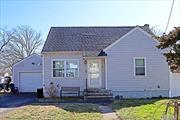 Great Starter Home! On Extra Large Property Reasonably Priced 4 Bedroom Cape Partically Finished Basement ! Won't Last ! Don't Miss Out!