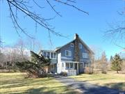If you have ever wondered what it would be like to live in the Gatsby era, you need not look further! This historic 11 room home is located in picturesque Shoreham Village. Just two blocks from this beach, this Village is a hidden enclave in our endless busy world. Enjoy the enclosed porches or build a fire in one of two fireplaces. Attend the Village's 4th of July parade or play tennis or paddle tennis. Enjoy the beach...so much to do here and over approx 4400 square feet in the home!