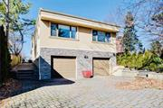 Spectacular waterfront 10, 843 Sq Ft Lot property in desirable area of Whitestone Woods. This contemporary home features 4 Br's, 5 Baths. Master bedroom is on the top floor w a balcony overseeing the Whitestone Bridge. Seller has approved plans for a 5, 000 sq foot house. Riparian Rights and able to build dock. Open Kit, Lr/Dr Looking out towards water. Spacious yard W breathtaking views, and only Steps Down To the Water. Must see!