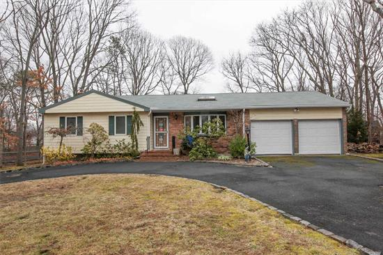 Large 4Bedroom Ranch Offering 2 Full Bathrooms - Large Size Rooms through out. Hardwood Floors, Living Room, Eat In Kitchen, Den with a Fire Place, Laundry Room, Private Laundry Area, Full Size 2 Car Garage, Full Basement, 2 Year Old Roof, Large Property. Burner 5 Years old. Must See! Close to Shopping, LIE & LIRR