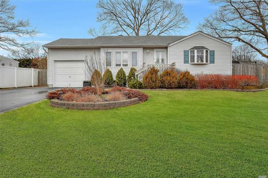 Opportunity knocks! Tons of updates & a Master Bath waiting for you to finish! Andersen windows, laminate floors, new carpet in all bedrooms, updated full bath, 2018 cesspool, 40gal.hot water heater 2019, New washer/dryer 2019, 200 amp electric w/generator hookup, 2011 Driveway w/paver edge, 1 car garage w/attic, EIK w/bay window, oak cabinetry, SS appliances, under cabinet lighting, pantry & side door to fenced yard. MBR w/walk-in closet. Full bsmt. CAC Fresh landscaping with solar lighting.
