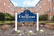 Beautifully Bright First Floor Unit In The Desirable Crescent Building. Unit Features A Large Entry With Walk-In Closet, Living Room, Formal Dining Area, Kitchen, 1 Bedroom And Full Bath. Lots of Natural Light And Closet Space Throughout. Building Features: Laundry Room & Garbage Disposal On Each Floor, Elevator, Gym, Community Room, Lobby Level Storage, Parking Lot & Parking Garage. Convenient To LIRR, Town Shops, Municipal Lot And Places Of Worship.