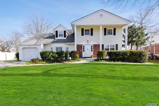 A meticulously maintained center hall colonial located in the Belmont Lake Estates section. Set on a park-like property with hardwood floors throughout, a large kitchen, and spacious bedrooms. Master bedroom ensuite with walk-in closets, ample storage space, attached garage and large full basement. Updated windows. Centrally located & close to all major transportation LIRR, SSP, LIE, shopping, dining, villages, NYC (60 Min), Hamptons, & South Shore Beaches. N. Babylon Schools. Welcome Home!