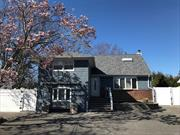 Beautifully Newly Updated Bellmore Split-Level Home, Featuring 4Br, Office/Possible 5th Br, 3Full Baths, Hardwood Floors, Lr/Dr, Den, Eik w/ Center Island, Granite Countertops, SS Appliances, Gas Cooking, French Doors Overlooking Backyard Deck, Suite-Like Br, 2 Skylights, Finished basement, Attic Storage, W/D Room, 5 Levels in All, Move in Ready!