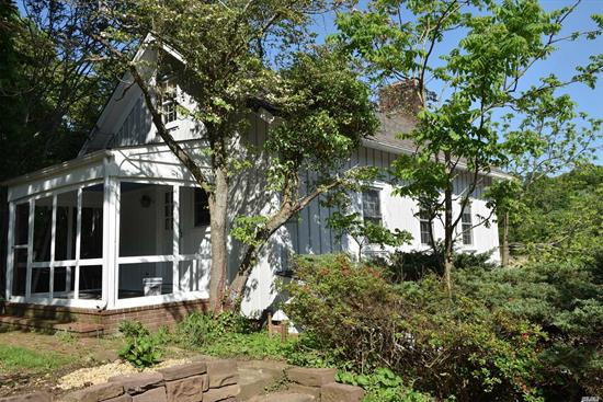 .Lovey Waterfront and Waterview Cottage Over Garage. Beautiful Panoramic Views of the Nissequogue River. Cottage Has Newly Refinished Hardwood Floors, Fireplace in Living room, Screened Porch, Two Bedrooms, and Use Of One Bay of Garage.