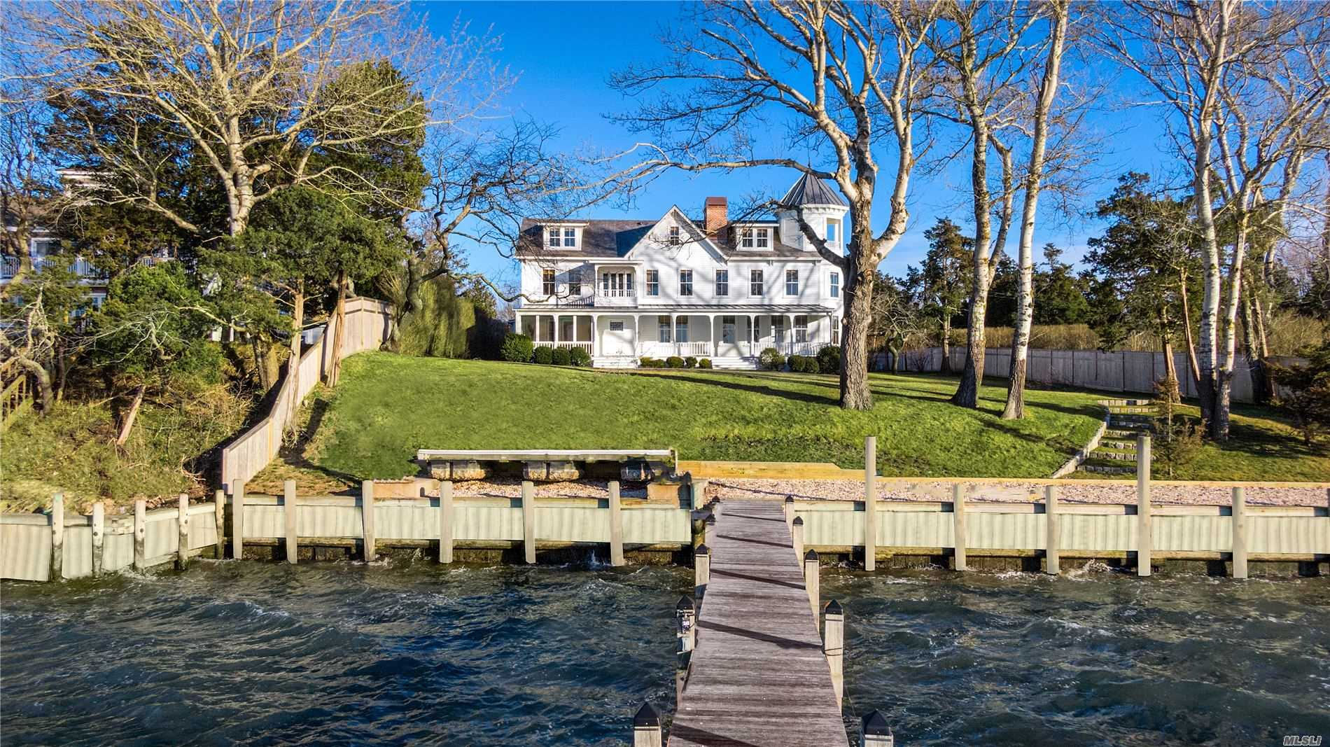 Located in Hampton Bays is this 1886 waterfront compound, The Peninsula House. Maintaining the original structure the current owner of the commenced a 2 yr restoration project. No expense was spared in the process & the home includes modern amenities. In addition to the main house, there is a pool house & carriage house on the north side. A few other things to note, new septic, all new irrigation & well, Sonos & dehumidification system.