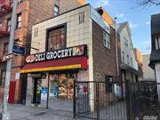 Great for investor or user. Top location deli plus 2 apartments. Driveway and garage