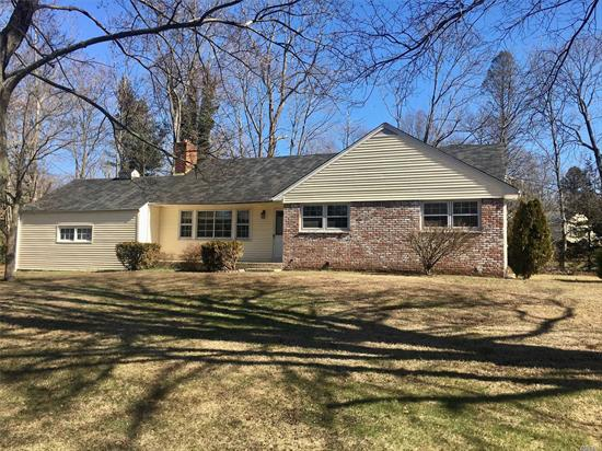 Sunny, light-filled 3 bedroom Ranch with 2 updated bathrooms in a nice neighborhood. Newly refinished hardwood floors, living room w/fireplace, den with french doors to backyard. Close to Stony Brook Train and Stony Brook University.