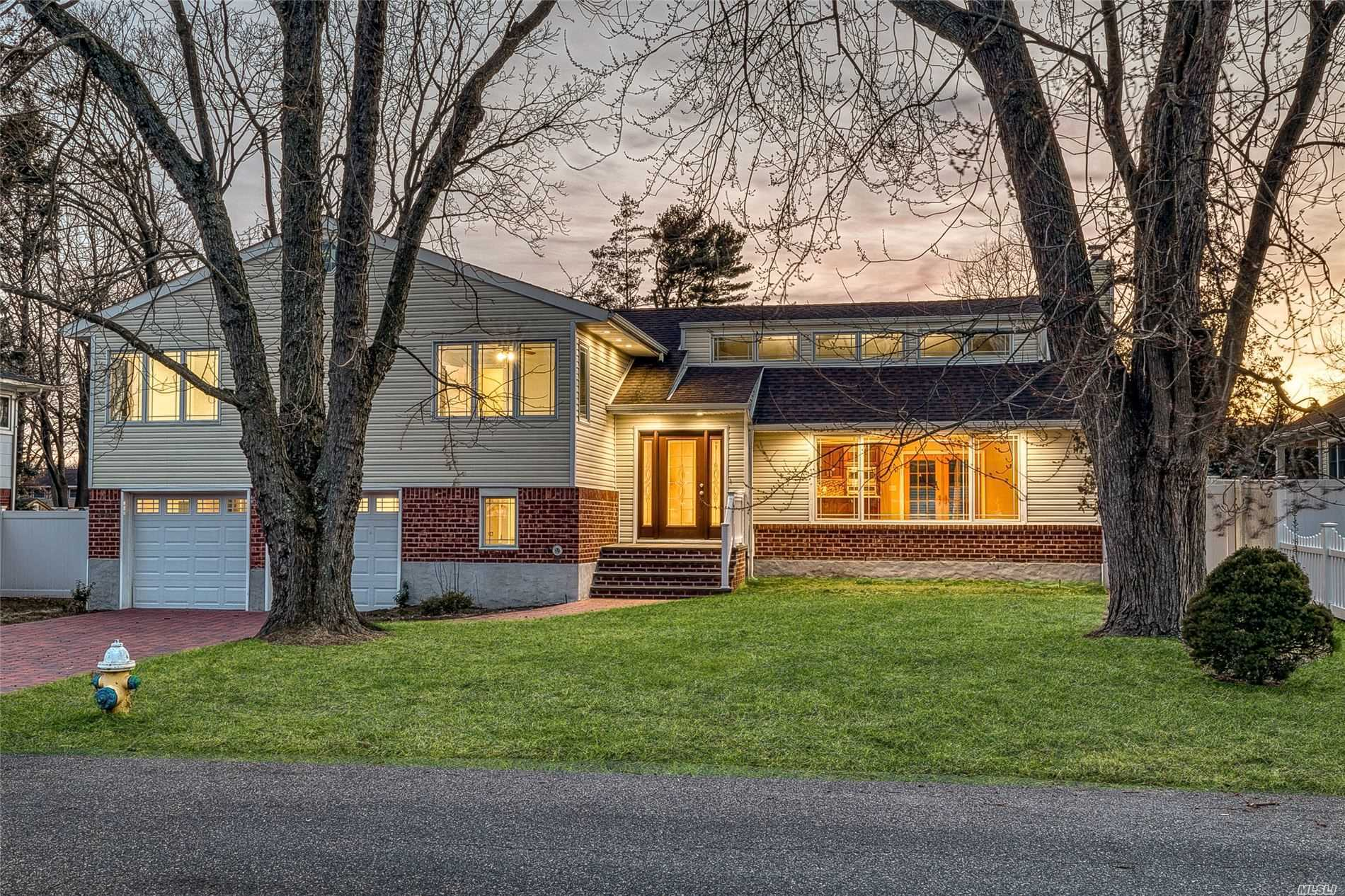 Completely Renovated & Redesigned 6 Bedroom, 3.5 Bathroom Expanded Split Level. Gorgeous Finishes Including Chef Style Kitchen & Designer Baths, Full Finished Basement & Finished Attic. Huge Property, Mother/Daughter W/ Permits.