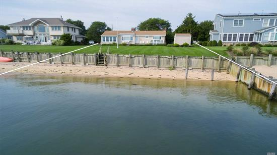 Stunning panoramic Bay Front views with 100 ft of sandy private beach. Home is set on a gracious lawn that is fully bulk-headed. Impeccably maintained Ranch, offering one floor living with foyer, living room with wood burning fireplace, eat-in kitchen, parquet wood floors, 3 bedrooms, 1 full bath, sun porch/dining room, stone patio with electric awning, full basement, attic, 1-car garage, shed & greenhouse.