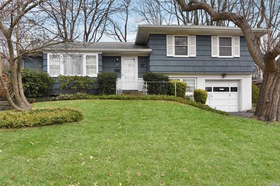 Wonderful home, prime location, oversized, flat property: this one has so much to offer. Classic split-level floor plan with living room opening to dining room and kitchen: three bedrooms up: family room at grade: plus basement. Manhasset Bay Estates Beach and mooring with membership and dues.