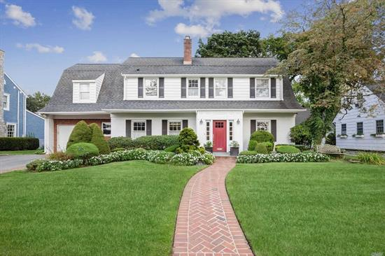 Charming, oversized Dutch Colonial in the heart of the Estates Section. 4 Spacious bedrooms on 2nd floor with 2 full updated baths. Beautiful eat-in-kitchen with luxury appliances & large island adjoins family room with dramatic stone fireplace and cathedral ceiling. Ideally located in close proximity to both LIRR train lines and GCHS. Private yard space with awninged patio area. A truly gracious home!