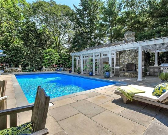 Book now for August 2021! This beautiful home features a gourmet chef's kitchen that opens into great room with cathedral ceilings, overlooking the pool and magical gardens. It has the perfect backyard: multi-level seating areas, swing set, pool house with outdoor kitchen and stone fireplace.