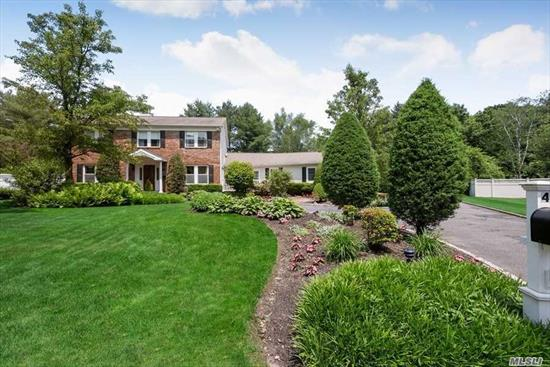 Entertainers Delight! Move Right into This Expanded Center Hall Colonial W/Spacious Rooms. Set On Quiet Cul De Sac W/ .71 Acres of Lush Professionally Landscaped Property. This Bright and Sunny Home Features a Granite Kitchen W/Stainless Steel Appliances & Beverage Refrigerator, Hardwood Floors, and a Magnificent Great Room Complete W/Wet Bar For All Your Entertaining Needs. The Pvt. Backyard Boasts A 20x40 IG Pool W/Newer Liner (2019)  Surrounded By A Beautiful Estate Fence. A MUST SEE!!!