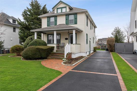 Charming Colonial, High End Marble EIK, & Front Porch. Oversized Lot 50 x 192. Generous Master, Dual Closets, ADJ Full Bath Minutes from RR. New Roof, Driveway, Great EIK, Young Appliances! CAC! , New windows! 200 AMP, Hedged Privacy, Low Taxes.Sewers;Shed; Flood Zone X According to Insurance