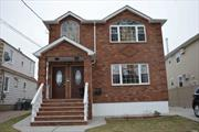 First floor in two family house, three bedrooms with two full baths with En-suite in master bedroom, living/ dining-room eat-in kitchen and wood floors.Heat not Included