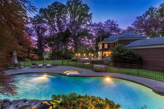 Magnificient Custom Built Colonial Located On An Acre Of Private Flat Lush Property. Top of The Line Appliances & Finishes, Beautiful Millwork & Impeccable Wood Work. Open Floor Plan w/3 Sided Custom Gas Fireplace. Incredible Master Suite and Master Bath Overlooking Gorgeous Property. Large Designer Patio w Outdoor Kitchen & Pergola. Salt Water Pool w Jacuzzi & Waterfall. Generator, Low Taxes. Roslyn SD. Eligible Discount For Golf Membership. A Gem! Please See Virtual Tour