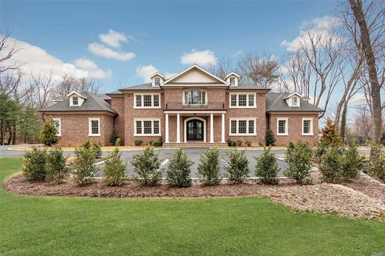 Sands Point. Distinguished All Brick Colonial Located In The Sough After Harriman Community W/Beach & Mooring Rights. On Over 2 Acres, W/6 Bedrooms & 6.5 Baths. This New Construction Home Features Bright & Open Spaces, Incredible Flow, Italian Porcelain Radiant Heated & Walnut Oak Floors, Custom Millwork, Incredible Master Bedroom Suite W/Double Sided Fireplace & Sitting Room, Formal Living Room W/Fpl, Office/Lib, Family Room W/Fpl, Fabulous Eat in Kitchen, Additional Maids Qrts, & More!