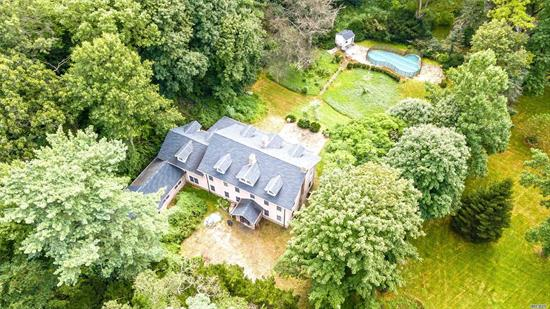 Town & Country Estate on 5.56A with potential for subdivision. Unfinished 5000+ sq.' Main house + Fabulous 1600+ sq.' Cottage. Sweeping grounds with inground pool, tennis courts on gated entry. A true North Shore Compound near Country Clubs, Restaurants & Shopping.