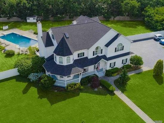 AMAZING 4900 SQ. FT VICTORIAN WITH WRAP AROUND PORCH, GRAND FOYER WITH LANDING, FORMAL LR, FDR, HUGE EIK WITH GRANITE AND SS, MASTER BEDROOM W/ 4WIC W/EN SUITE, JACUZZI BATH, & FIREPLACE IN MASTER LIVING ROOM. BR 2, 3, 4 AND 3 ADD'L BATHS, DEN W/14 ' CEILINGS, OAK FLOORS, FULL FINISHED BSMT WITH OUTSIDE ENTRANCE, 2 CAR GARAGE AND 10 CAR DRIVEWAY, 15X30 IGP WITH LOOP LOCK COVER