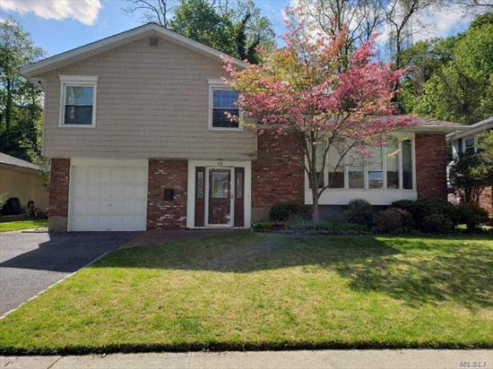 Totally renovated 4 level split house, right move-in condition, Eastern exposure, spacious & airy entrance to sunny & bright Cathedral ceiling living room, formal dinning room, renovated kitchen w/granite counter top and stainless steel appliances, sliding door to huge deck, new dual door bath room, master br, good sized additional 3 brs, 2nd new bath, family room, many closets, through-out hardwood floors, manicured landscaped garden, house is on the cozy street, walking distance to LIRR, shopping +++
