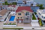 Spend the Summer at the beach or in a heated in ground pool!!! Exquisite Diamond Condition Colonial built in 2016 with breathtaking views of the Open Bay from two decks. Owner added In Ground Pool Complex with Pavers and Lounge Area backed by privacy trees, Slide and Rock Waterfall! Open Kitchen of your dreams to great room with fireplace and vaulted ceilings. Master Suite with full bath and two walk in closets will make you feel like you are in a luxury hotel. Incredible sunrises and sunsets! BEST SUMMER RENTAL!!!