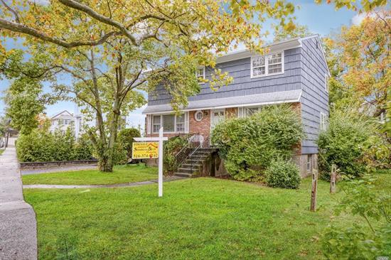Spacious Center Hall Colonial with a Great Flow on Desirable Block of Far Rockaway. All 4 Large bedrooms on 2nd Floor, Hardwood Floors beneath Carpets, Lg Living Room w/Fpl, Family room with Access to Deck and Yard. Extra large full unfinished Basement. Private Driveway. A rare find!