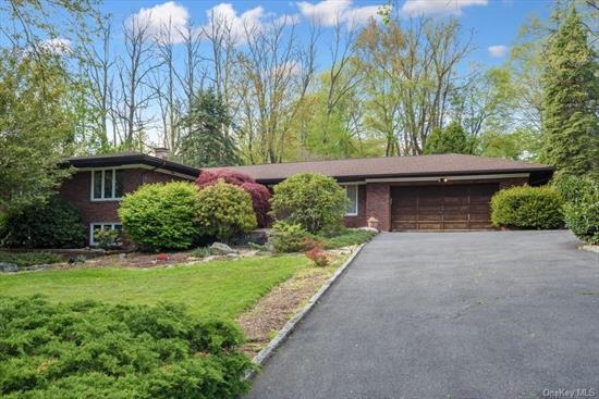 Welcome to 3 Taylor Rd in the Pocantico Hills Central School District https://www.pocanticohills.org/mission__vision A custom built mid century modern brick and stone enclave, built by the accomplished builder (who built skyscrapers in Manhattan) Joseph Stargiotti for his young family in 1965. This home's interior features brick arches, a 2 story stone wall, sunken living room and formal dining room, first floor master + 2BR, EIK and family room - all on the main level. (HARDWOOD under upstairs bedrooms & hallway carpeting). STEEL BEAMS SUPPORT THE MAIN LEVEL/NO COLUMNS LOWER-LEVEL. Radiant heat in the entry hall, dining room & sunken living room. There is plenty of space to play in the retro 60's adult playroom with a built in custom-made bar and regulation pool table + 3 additional bedrooms/office/ guest room(s) and full bath all on the lower level (1, 056 additional sq ft) - accessed by Anderson sliders. The home is set back and surrounded by gentle rolling landscaped hills and includes a special area set aside for a gentleman's farm. Convenient to shopping, major highways, downtown White Plains and Metro North. Real Estate taxes are under $18, 000 (not including STAR deduction) . Please enjoy a 3-D self-guided tour of what could be your next home.