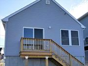 **New Construction Waterfront Home** Turnkey, move right in! 2 bdrm, 1 bth with boat dock! All New; Roof, Siding, Windows, Tankless boiler, bthrm etc. Too much to list! Bay Park - E. Rockaway, no village taxes! On cul de sac! Taxes grieved & expecting 15% reduction! Make an appt to view before it's gone!
