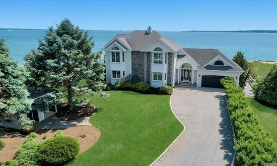 The One You Have Been Waiting For! Light and Bright, Open Floor Plan Bay Front Home with Gourmet Kitchen, Living Room with Fireplace, 1st Floor Master Suite, Open Loft Sitting Area on 2nd Floor and Bay Views from All Rooms. Waterside Patio with Pergola. 2 Car Garage Plus Storage Shed. Generator. Hurricane Shutters.