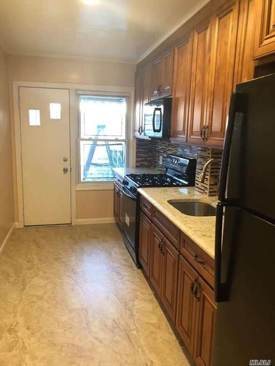Renovated from head to toe. Full house rental, large eat in kitchen with new appliances, big finished basement. the house includes a backyard and driveway. great location across from st.johns and union tpke.