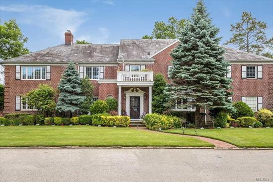 Magnificent brick Harris colonial on half acre lot on quiet cul-de-sac in Lawrence. 7 bedrooms, 6 bathrooms, full finished basement, stunning yard, endless potential.