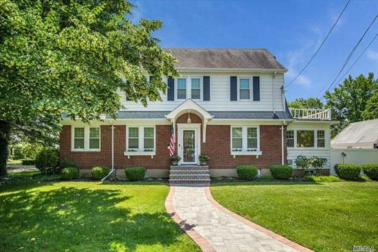 Charming Center Hall Colonial In North Syosset. Mahogany Inlaid Wood Floors 9foot Ceilings, French Doors, Large Center Island Eat In Kitchen, OverSized Living Room With Wrap Around Windows And Fireplace, Large Formal Dining Room, Additional Den. 3rd Story Finished Attic Could Be 4th Bedroom Or Office. Full Finished Basement With Laundry. Second Story Balcony Deck. Close To Town And LIRR.
