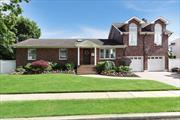 All Brick Expanded Ranch on Oversized Property. House Features a Large Family Room with Fireplace, Full Finished basement w/Fireplace, Hardwood Floors, Radiant Heat in Kitchen and Baths, CAC, Electric 200amp, and Two Car Garage. Fenced in Yard with Heated In-Ground Pool, and Sprinkler System. Convenient to all.