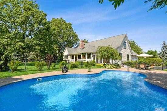 OPEN HOUSE by appointment Saturday Aug 8 -- 1PM to 2:30. Enviable setting in Fairway Farms overlooking manicured gardens, heated saltwater pool & the 17th Hole of the North Fork Country Club. Distinctive presence in this 2800 SF Post Modern Single Story 4BR, 3 Bath Home. Living room features vaulted ceiling with recessed lighting and skylights, wood burning fireplace and access to deck. Sun drenched kitchen with dinette, a breezy screened porch {the perfect place to enjoy a morning cup of tea), formal dining room, main floor laundry and generous closet space throughout. The comfortable master suite with vaulted ceiling includes a separate office/nursery or sitting room overlooking the yard and golf course. There is a large dressing room off the master bath. Need more room? There's a huge walk up attic and full basement with 10 foot ceiling and OSE, too. Both perfect for expansion. The 11 acre creek front preserve at the end of the lane is a relaxing paddle in your kayak to the bay.