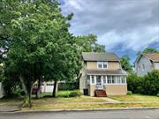Huge potential! Large property in a great location. Quiet block, plenty of room for expansion, 2 car garage, large eat in kitchen, hardwood floors. Updated bath. Owner is a contractor and is willing to build to suit. Full new construction is possible on this beautiful lot.