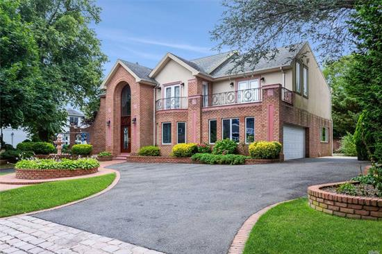 Magnificent CH Colonial, Prime Location In Lawrence. Enter Thru Mahogany Doors, Marble Entry Way, Formal Living Rm W/Fplc, Formal DR, Gourmet Eik W/Granite Countertops, 2 Dishwashers, 2 Sinks, Double Oven, Sub-Zero Refrigerator & Work Station. Den W/Fplc, Huge MBR En-Suite & Lux Bathroom + Balcony. Full Finished Basement, CAC, IGS, Alarm, Gas Line BBQ, Plus So Much More. A Must See!!!