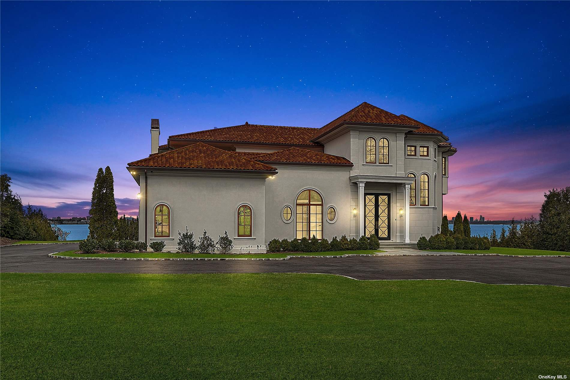 BREATHTAKING WATERFRONT OFFERING Expansive water views of the Long Island Sound, Manhattan, Throgs Neck Bridge,  Westchester and Connecticut may be enjoyed year round within this elegant new construction in the Prestigious Village of Kings Point. Privately located the end of this beautifully tree-lined cul de sac, this artistically-inspired residence is currently being completed by well known and respected Rockwell Developers LLC. The attention to detail with a clean lined approach is apparent the moment you enter this magnificent residence with its elegant curved staircase, formal dining room with custom walls and gold lined accent, herringbone wood floors, an oval shaped custom blue colored library or office with walls of windows and FPLC, and the inviting eat-in-kitchen with custom cabinetry, marble countertops, and high end appliances, just to name a few. 1.46 Acres of water and private beachfront.