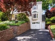 Surrounded with beautiful lush landscaping, this traditional 3 BRS 1.5 BTHS CH Colonial offers charming architectural details throughout. Inviting front terrace w/awning, gracious LR w/fpl, elegant FDR, updated kitchen w/granite counters is adjacent to large family room. Private serene yard with tiered landscaping and specimen plantings.