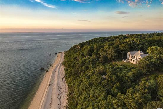 This home oozes calm, cool and collected vibes and Spectacular Sunsets! 1.25 acres of gorgeous Sound front with stairs leading to 125' of Long Island Sound beach. This John Bertani built home has an open floor plan and features a gourmet chefs kitchen with 3 dishwashers, Wolf appliances, sub zero wine fridge and Granite counter tops, formal dining, great room w. a fpl, a den, 4 bedrooms, including a master en-suite with a waterside balcony and 2nd floor loft. Walkout basement with changing room and a full bathroom, attached 1 car garage and a separate detached 2 car garage, with a loft. Enjoy incredible panoramic views of the water while also being surrounded by North Fork award winning vineyards, renowned restaurants, farm stands, boating and great shopping. A true gem!