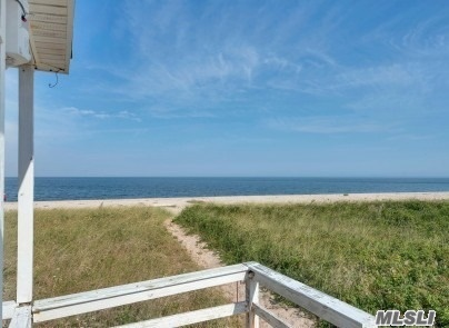 Best deep(100' from deck to high water mark) and level sandy beach on the North Fork awaits your presence. Situated on the beautiful North Fork, your pristine setting and spectacular sunsets includes a seasonal 1578 sqft beach cottage with 7 rooms, 2 baths plus a 2nd floor loft and water view covered deck.
