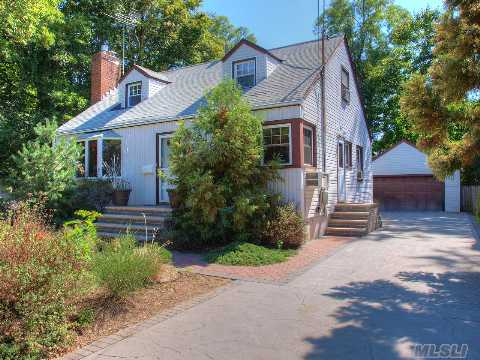 Charming Simplicity In Updated Cape - Perfect For First Time Homebuyers! Kitchen With Granite Countertops, Wood Cabinets And Hi-Hats, Living Room With Gas Fireplace And Hi-Hats, Cedar Closets, New Masonery Including Driveway, Stoop & Paver Walk, Fully Fenced Lot. Home Warranty Included. Minutes To Jones Beach, Shopping, Lirr. Must See To Appreciate - Call Now!