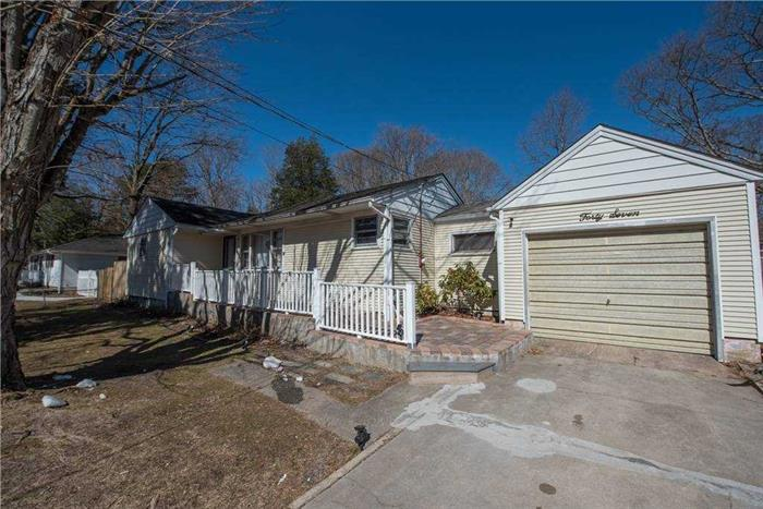 A Charming 3 Bedroom, 1 Bath Ranch Set Back On 1/2 Acre of Land. Full Basement, 1 Car Attached Garage.