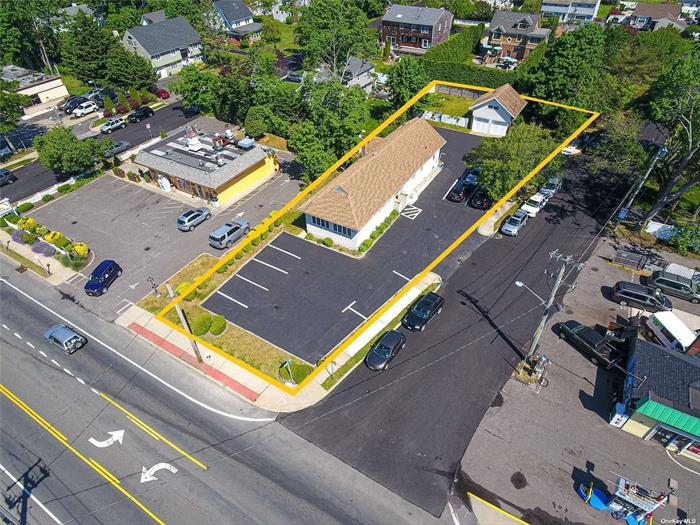 Zoned Business 1, This Office Building Enjoys Tremendous Exposure And High Traffic Count. ADA Compliant. Approximately 1738 Square Feet, Plus A Detached 360 Square Foot Garage With Loft. Utility Basement with Exterior Entrance. Taxes = $ 19, 753.23