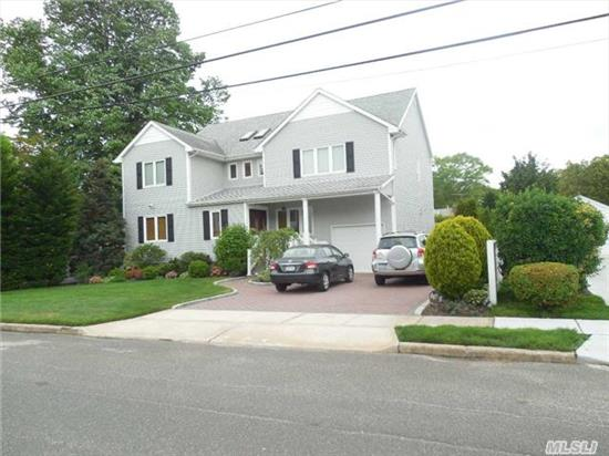 This House Has It All.Beautifully Renovated In 2005. 5Brs, 3.5Baths, Den W/1/2 Bath, Lg, E-I-K W/Radiant Heat, Covered Back Porch W/Ceiling Fans Overlooking Oversized Property. 20X20 Master Suite W/Bath--2Brs W/Jack & Jill Lg. Bath. Wood Flrs Thruout/ 2Yr Old Sep Hot Water Heater/ 12Yr Burner, 5 Zone, 200Amp, 10Yr Roof & Windows