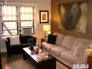 Beautiful 1 Br In Ideal Location. Renovated Kit And Bath, Hardwood Floors, Custom Lighting. Pet Friendly Building. Close To Express Subway And Shops.