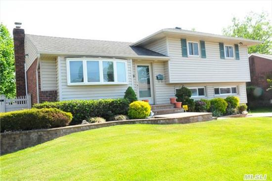 This Split In Mid Block Location Features Professional Landscaping,  Newer Kitchen, Newer Windows & Siding, Newer Roof, Wood Floors, Extended Den Beautiful Fenced Yard Perfect Location - Must See!