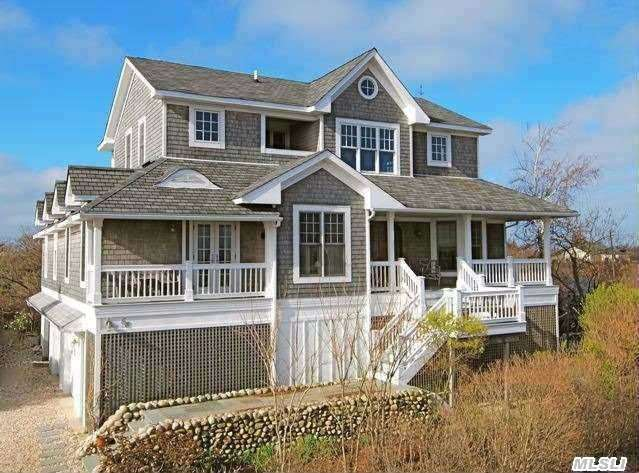 .This Architectural Gem One Of The Beach's Best Deals! Panoramic Water Views Of Sunrises & Sunsets Over The Fire Island Inlet. Access To Private Sandy Beach With Mooring Included. This Custom House, Completely Rebuilt In 2004 Includes Grand Entry, Formal Dining Room With Tin Ceiling, Master Bedroom With Elegant Full Bath & Private Decks.