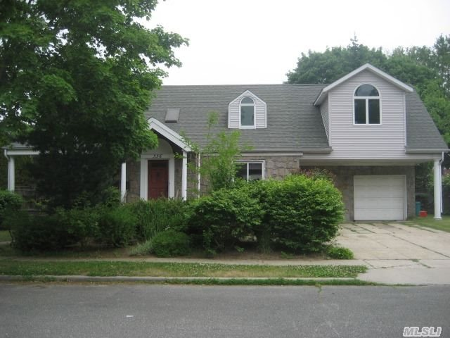 1 Of A Kind Colonial On Cul De Sac W/ 5 Bedrooms Upstairs. Lg. Main Floor W/ Family Room, Sitting Area And Mudroom W/ Access To Attached Garage. Hw Floods Throughout. Newer Roof And Windows, Skylights, Central Air And Gas Cooking. Large Front Porch And 2 Car Driveway. Alarm.