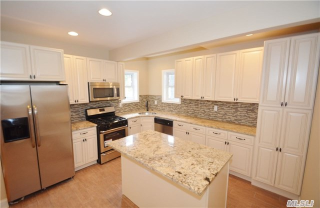 This House Won't Last Long, Come See This Fully Renovated 2 Family Home In The Westwood Section Of Award Winning School District 20 Featuring Granite Countertops, All New Windows, Electrical Service & Boiler. Close To Lirr, Parkways And All Public Transportation.